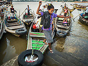 27 OCTOBER 2015 - YANGON, MYANMAR: A woman gets off a cross river ferry at Aungmingalar Jetty in Yangon. The jetty is one of the numerous crossing points that bring people from the suburbs on the other side of the river into Yangon.    PHOTO BY JACK KURTZ