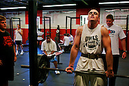 Quarterback Paul Wayne lifts 315 pounds during an afternoon weightlifting session at the high school. He works out there 3 times a week at 5.30 AM and sometimes adds an extra afternoon session.