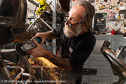 Micah McCloskey working on Keith Ball's Bonneville Salt Torpedo belly tank trike in the Bikernet World HQ shop in Wilmington, CA, USA. Monday, June 24, 2019. Photography ©2019 Michael Lichter.