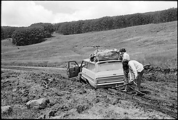 Our Gang, Stuck in the Mud in Dixie National Forest. Attempting to free our '64 Chevy Bel-Air Station Wagon with a stick. Eventually help came along and we got going again. Photograph taken on 19 July 1973.