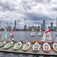 Boston skyline photography featuring iconic landmarks along the Charles River, such as the Prudential Center and 200 Clarendon better known as the John Hancock Building. Partly cloudy skies were in the weather forecast and I was a bit hesitant but boy am I glad I went. The sailing boats and early spring colors added a colorful punch while the overcast sky showed beautiful grey tones and different cloud formations. <br />