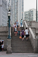 people climbing steps in Shanghai China
