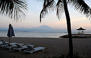 Bali's sacred mountain, Gunung Agung, viewed from Sanur beach at sunrise. Sanur, Bali, Indonesia.