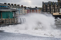 © London News Pictures. 07/02/2016 Aberystwyth, Wales, UK. Stormy seas lash the promenade and sea defences at high tide. Storm warnings have been issued for parts of the UK overnight tonight and into Monday . Photo credit: Keith Morris/LNP