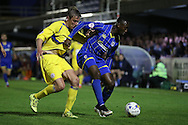 Adebayo Azeez of AFC Wimbledon shields the ball from Tom Davies of Accrington Stanley. Skybet football league two play off semi final, 1st leg match, AFC Wimbledon v Accrington Stanley at the Cherry Red Records Stadium in Kingston upon Thames, Surrey on Saturday 14th May 2016.<br /> pic by John Patrick Fletcher, Andrew Orchard sports photography.