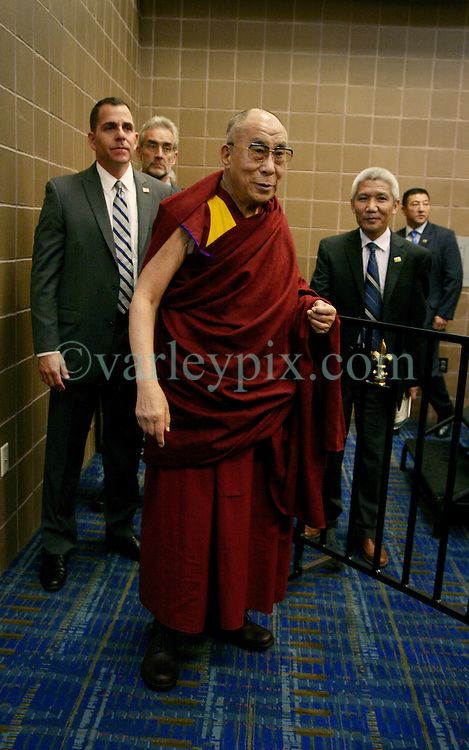 17 May 2013. New Orleans, Louisiana,  USA..His Holiness the 14th Dalai Lama arrives at a press conference at the Morial Convention Center  in New Orleans before speaking at the 'Resiliance - Strength through Compassion and Connection' conference. .Photo; Charlie Varley.