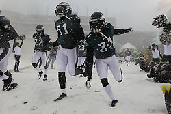 Philadelphia Eagles cornerback Roc Carmichael #21 enters the field with the team before the NFL game between the Detroit Lions and the Philadelphia Eagles on Sunday, December 8th 2013 in Philadelphia. (Photo by Brian Garfinkel)