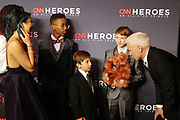 December 17, 2017-New York, NY-United States: Journalist Anderson Cooper speaks with the 2017 Young Wonders as they attend the 11th Annual CNN Heroes All-Star Tribute held at the American Museum of Natural History on December 18, 2017 in New York City. The All-Star Tribute ceremony honors everyday people changing the world. Terrence Jennings/terrencejennings.com