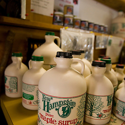 Jugs of maple syrup in the sugar house at the Sunday Mountain Maple Farm in Orford, New Hampshire.