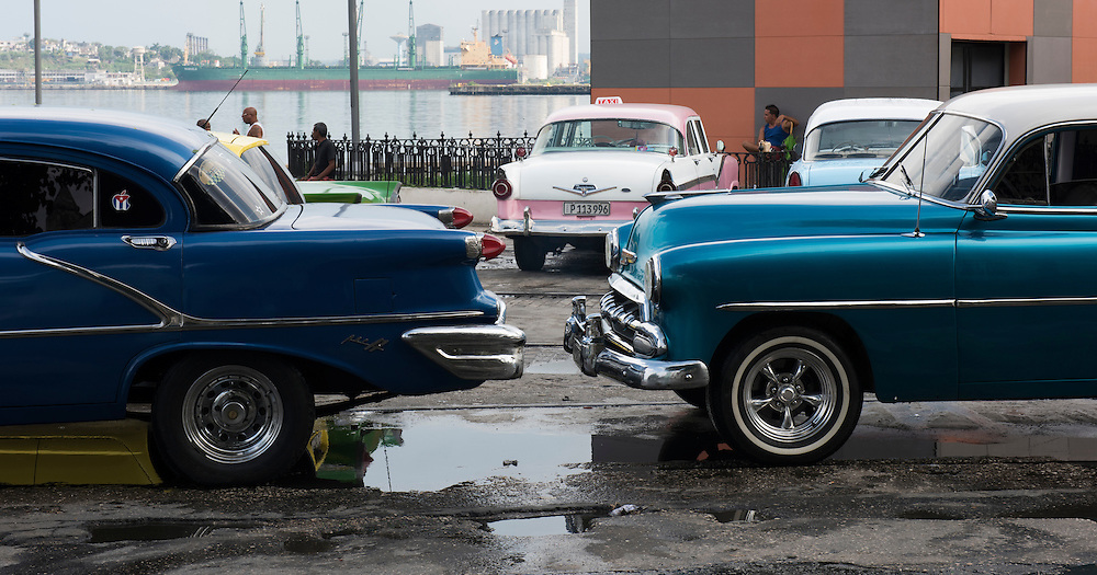 Havana, Cuba - October 2015: Havana's streets are studded with old classic American cars. The US embargo and the local restrictions on car purchases give Cuban few alternatives but to keep the vintage cars running.