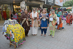 April 25, 2018 - Lahore, Punjab, Pakistan - Leader of of Pakistan Tehreek-e-Insaf (PTI) Women Wing Mussarat Jamshed Cheema,Sadia Sohail Rana and others women activists are distributing pamphlets among people in the local markets. (Credit Image: © Rana Sajid Hussain/Pacific Press via ZUMA Wire)