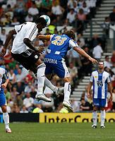 Photo: Steve Bond.<br />Derby County v RCD Espanyol. Pre Season Friendly. 04/08/2007. Claude davis (L) challanges raul tamudo (R)