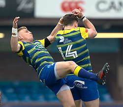Cardiff Blues' Gareth Anscombe with team-mate Alex Cuthbert collide going for a high ball<br /> <br /> Photographer Simon King/Replay Images<br /> <br /> European Rugby Challenge Cup - Semi Final - Cardiff Blues v Pau - Saturday 21st April 2018 - Cardiff Arms Park - Cardiff<br /> <br /> World Copyright © Replay Images . All rights reserved. info@replayimages.co.uk - http://replayimages.co.uk