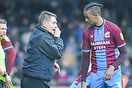 Andy Dawson of Scunthorpe United (Manager) and Cameron Borthwick-Jackson of Scunthorpe United (3) chat during the EFL Sky Bet League 1 match between Scunthorpe United and Bradford City at Glanford Park, Scunthorpe, England on 27 April 2019.