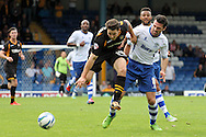 Newport County's Conor Washington is tackled by Bury's Tommy Miller ®. Skybet Football League two match, Bury v Newport county at Gigg Lane in Bury on Saturday 5th Oct 2013. pic by David Richards, Andrew Orchard sports photography,