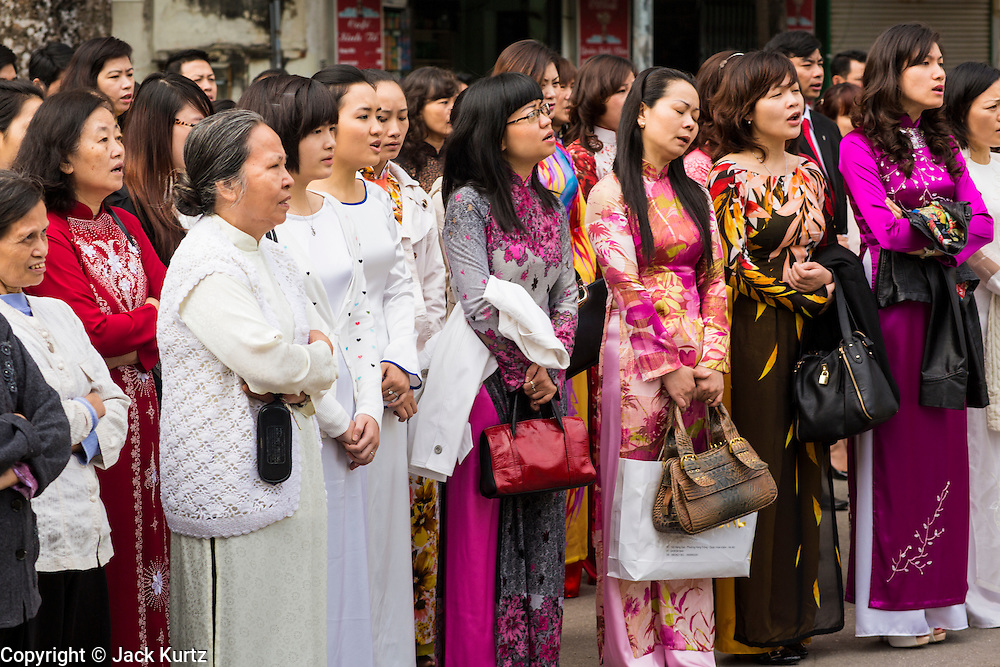 08 APRIL 2012 - HANOI, VIETNAM:   People pray in the square in front of St. Joseph Cathedral after Easter Sunday mass in St. Joseph Cathedral in Hanoi, Vietnam. St. Joseph Cathedral in Hanoi is the seat of the Roman Catholic Archdiocese of Hanoi and is one of the most important Catholic churches in Vietnam. It was built in 1886 and is especially crowded on religious holidays, like Easter. The church holds three Easter masses on Easter Sunday morning. There are more than 5.6 million Roman Catholics in Vietnam, nearly 7% of the population. Catholicism came to what is now Vietnam with Portuguese missionaries in the 16th Century, but it wasn't until the arrival of French missionaries and later colonial authorities that Catholicism became a part of Vietnamese religious life.    PHOTO BY JACK KURTZ