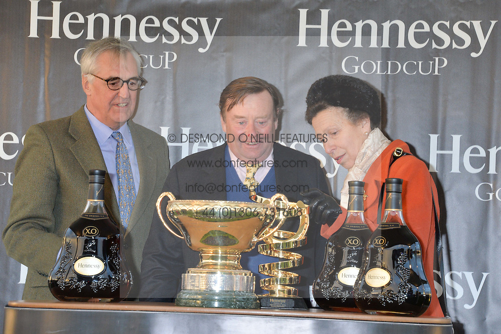 Left to right, MAURICE HENNESSY, NICKY HENDERSON and HRH The PRINCESS ROYAL at the 2013 Hennessy Gold Cup at Newbury Racecourse, Berkshire on 30th November 2013.