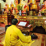 A Buddhist monk prays in front of the main altar at Tran Quoc Pagoda on a small island on West Lake (Ho Tay). Originally built in the 6th century on the banks of the Red River, a changing course of the river forced the pagoda to be relocated in 1615 to Golden Fish (Kim Ngu) islet on the lake.