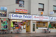"""College Falafel, widely considered one of the best shawarma shops in the city of Toronto, is located on Ossington Ave.  Shawarma is an Arab sandwich-like wrap of shaved lamb, goat, chicken, turkey, beef, or a mixture thereof. The meat is placed on a spit, and may be grilled for as long as a day. Shawarma is a fast-food staple across the Middle East, Europe and the Caucasus. Shawarma is eaten with pita bread, lavash, tabbouleh, fattoush, taboon bread, tomato and cucumber. Toppings include tahini, hummus, pickled turnips and amba. The word shawarma comes from the Turkish word çevirme, 'turning', though the dish is usually called döner kebab 'turning kebab' in Turkish. In Armenian, it is """"tarna"""", literally meaning """"to turn."""""""