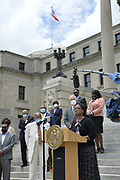 6/29/2020 Jackson MS.<br /> The Congressional Black Caucus held a press conference in the shadow of the Confederate flag,  on the Capitol steps in regard to the historic vote to remove the Confederate flag. After 126 years the Confederate Flag is finally coming down.  The Mississippi Black Caucus expressed what a historic day this was for the State of Mississippi. They also stated how it was past time to remove the racist symbol from the state flag. The MS House of Representatives passed the Bill 91-23 and the MS Senate voted 31-14 in favor of changing the flag. The Bill would allow for the redesign of the Mississippi State Flag, the current flag has the Confederate symbol on it. Mississippi is the last State in the Nation to still have the stars and bars of the Confederate symbol on its state flag.  Governor Tate Reeves said he would sign it if it passed the State is now waiting for his signature on HB1796. Photo © Suzi Altman @suzialtman #mississippi #history #change #flag #confederateflag    #ms #blackcaucus #racism #BLM #equality