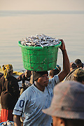 On the shore of Senga Bay, usipa is sold in quantities that range from buckets to boatloads, Lake Malawi, Malawi.