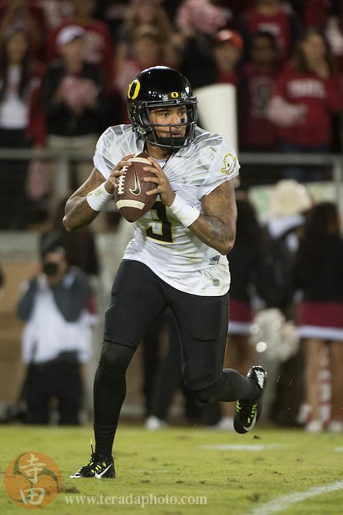 November 14, 2015; Stanford, CA, USA; Oregon Ducks quarterback Vernon Adams Jr. (3) looks for a receiver during the fourth quarter against the Stanford Cardinal at Stanford Stadium. The Ducks defeated the Cardinal 38-36.