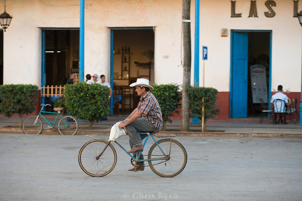 Man riding bicycle on streets of Remedios, Cuba