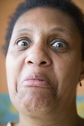 Portrait of a woman making a face,