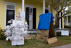 21 December 2005. New Orleans, Louisiana. Post Katrina aftermath.<br /> Uptown, Penniston Street. A humorous refrigerator Christmas tree. Refrigerators litter the city following Hurricane Katrina where food sat rotting for weeks and months with no power, here a resident tries to inject a little humour into the season.<br /> Photo; ©Charlie Varley/varleypix.com