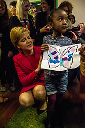 Pictured: Nicola Sturgeon, MSP, meets four year old Nosim Mwiki who had made a magic butterfly picture for the First Minister<br /> <br /> Nicola Sturgeon, MSP, paid a visit today to Shakti Women's Aid in Edinburgh today to campaign against the Rape Clause. <br /> Ger Harley   EEm 25 April 2017