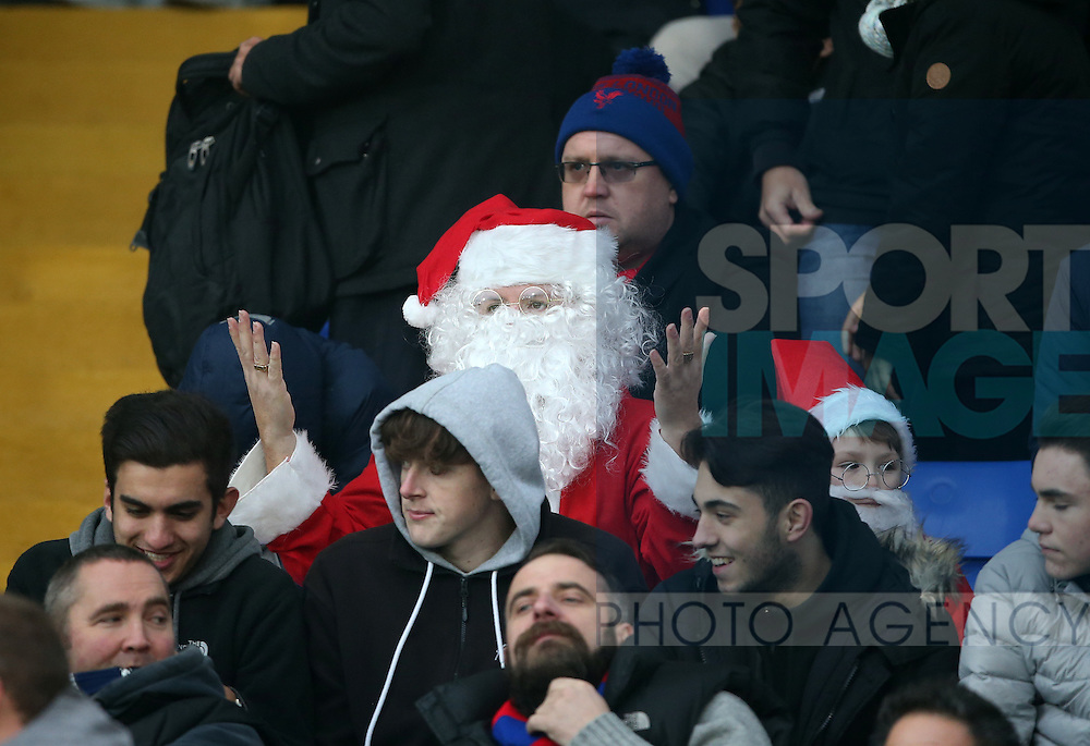 A Crystal Palace fan dressed as Santa looks on dejected during the Premier League match at Selhurst Park Stadium, London. Picture date December 17th, 2016 Pic David Klein/Sportimage
