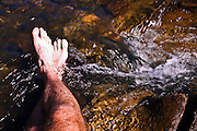 Bare feet in the San Juan River, Pagosa Springs, Colorado