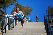 Blonde Girl Stretching on the Stairs at Lantern Bay Park in Dana Point
