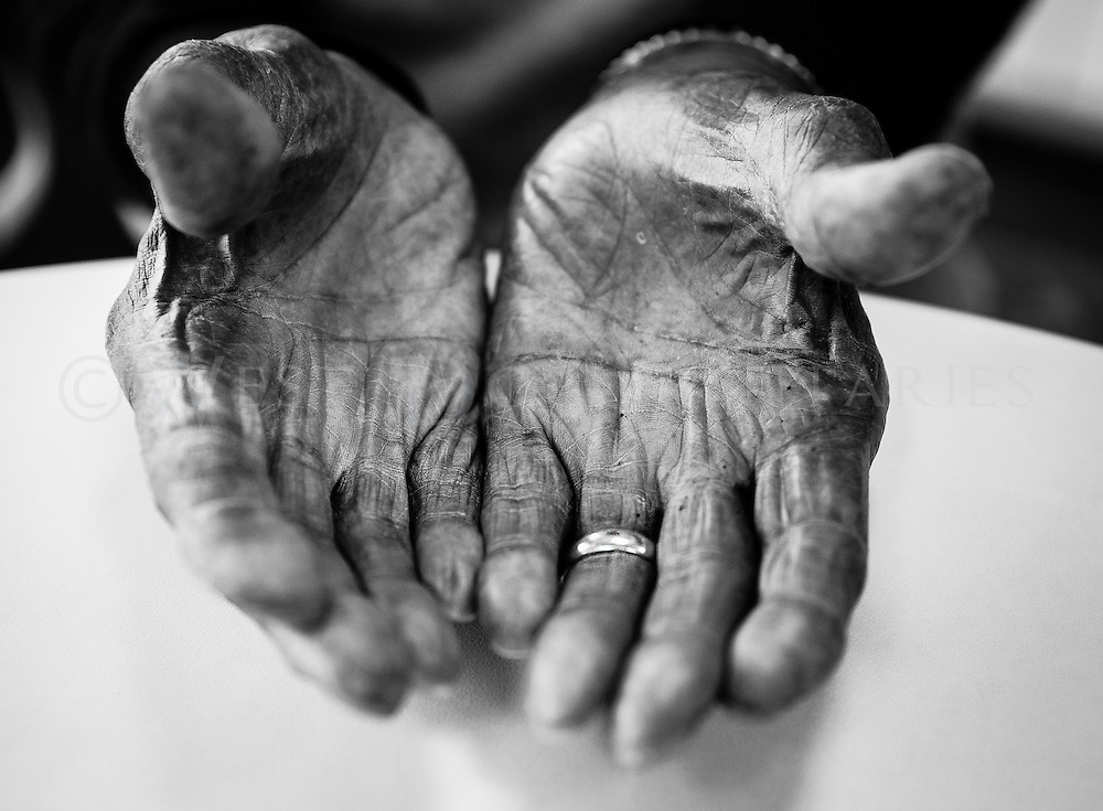 Edward Curtis, a 97-year-old employee of Alfred Williams and Company, Raleigh, who started work at the business in 1935 and has been continuously working for the past 80 years, takes a moment to have a photograph of his hands made on April 15. Curtis started off as a driver and cook for the Williams family and then was drafted into World War II, eventually returning to Raleigh to start working at Alfred Williams and Company full-time and has been there ever since.