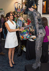The Duchess of Sussex meets actors in costume during a visit to Courtenay Creative, in Wellington, on day two of the royal couple's tour of New Zealand.