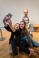 BENTONVILLE, AR - FEBRUARY 15:  Molly McGath and Kate Pittman shoot a selfie in front of art display at Crystal Bridges Museum of American Art in Bentonville, Arkansas.<br /> CREDIT Wesley Hitt for The Wall Street Journal<br /> WALMART-Bentonville Scene-setters