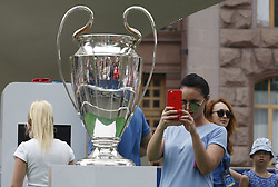 May 25, 2018 - Kiev, Ukraine - Soccer fans pose for photos next to the Champions League trophy at the UEFA Champions League Final fan zone in Kyiv, Ukraine, 25 May, 2018. Real Madrid will face Liverpool FC in the UEFA Champions League final at the NSC Olimpiyskiy stadium on 26 May 2018. (Credit Image: © Str/NurPhoto via ZUMA Press)