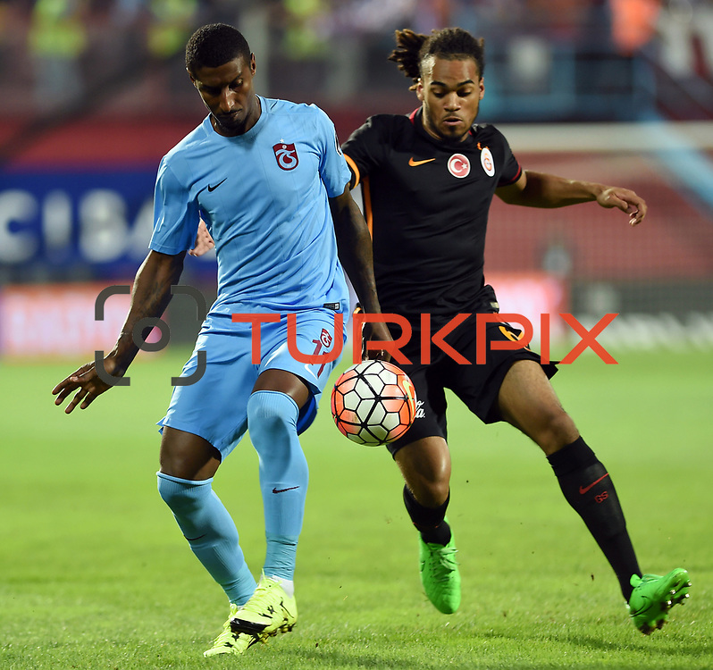 Trabzonspor's Kevin Constant (L) and Galatasaray's Jason Denayer (R) during their Turkish Super League Derby match Trabzonspor between Galatasaray at the Avni Aker Stadium at Trabzon Turkey on Saturday, 19 September 2015. Photo by TVPN/TURKPIX