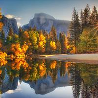 Autumn sunrise over Half Dome and the Merced River, Yosemite National Park, California.