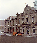 A very imposing building pictured in 1988. the building is in Dublin. there are several pictures of this building in the collection. If you know the building or location please let us and we will update the data.<br /> <br /> <br /> <br /> Old amateur photos of Dublin streets churches, cars, lanes, roads, shops schools, hospitals, Streetscape views are hard to come by while the quality is not always the best in this collection they do capture Dublin streets not often available and have seen a lot of change since photos were taken Old Fire, Blackrock, Library, Bookshop, Carraig Books, St Patrick's Cathedral from Clanbrassil st April 1984