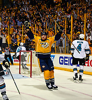 NASHVILLE, TN - MAY 09:  Colin Wilson #33 of the Nashville Predators holds his hands up in celebration after scoring the game tying goal during the third period of Game Six of the Western Conference Second Round against the San Jose Sharks during the 2016 NHL Stanley Cup Playoffs at Bridgestone Arena on May 9, 2016 in Nashville, Tennessee.  (Photo by Frederick Breedon/Getty Images)