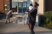 Student Profile: Ke'Von Miles hugs his brother on graduation day.
