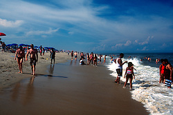 Unidentified sun worshipers dip their toes in the waters of the Atlantic Ocean, Saturday, Aug. 17, 2019, in Rehoboth Beach, Del. (Photo by D. Ross Cameron)