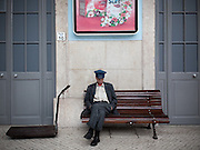 A porter have a little rest at the Santa Apolónia railway station, in central Lisbon.This photograph is part of a body of work about Lisbon, feelings, affections and loneliness. Is about a city depressed by the crisis, but even so, tolerant and cosmopolitan. This part of Lisbon, the old town near the river Tejo (Tagus), with his deep character, where local people meets foreigners and alternative ways of life mixes with shamefaced poverty, is sublime by its peculiar light.