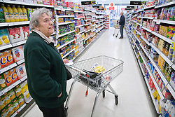 Older woman shopping for groceries in a supermarket,