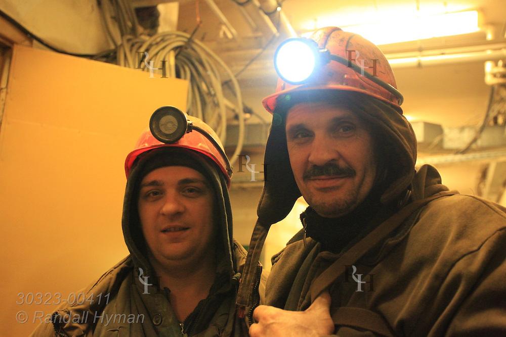 Ukrainian coal miners gear up in basement of Arktikugol offices before descending into Barentsburg mine; Svalbard, Norway.
