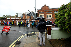 Fans arrive at a wet Craven Cottage for the Premier League fixture between Fulham and Burnley - Mandatory by-line: Robbie Stephenson/JMP - 26/08/2018 - FOOTBALL - Craven Cottage - Fulham, England - Fulham v Burnley - Premier League