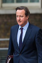 Downing Street, London, June 16th 2015. The British Prime Minister David Cameron walks up Downing Street after returning from Parliament.