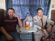 Two brothers trabelling to Kashgar. Life inside the train - mostly Muslim Uighur people  ride this train.