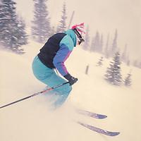 A skier descends new powder on The Burn at Breckenridge, CO.
